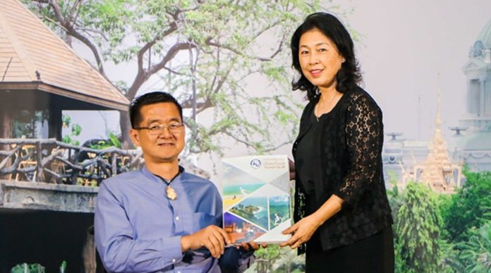 Mrs. Somrak Kumputch, TAT Deputy Governor for Administration, presents the Tourism for All guidebook to Mr, Krisana Lalai, President of Friendly Design for All Foundation, a human rights worker and a famous journalist and TV host in Thailand.