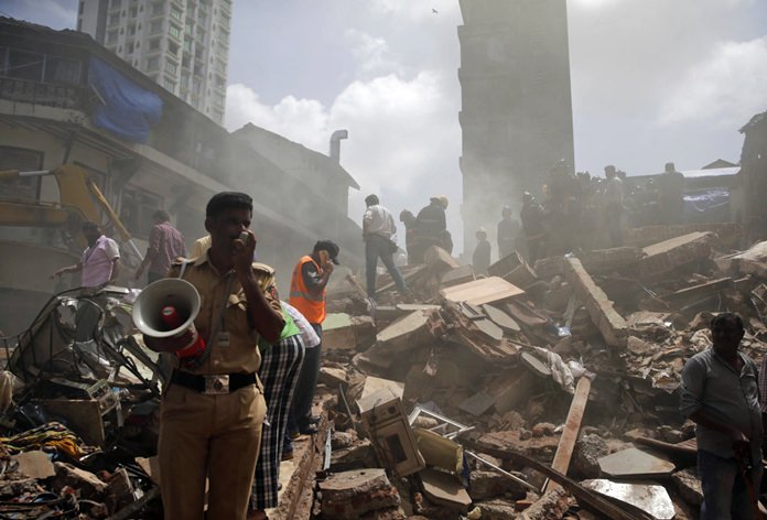 Rescuers at India building collapse find 15 injured, 33 dead. (AP Photo/Rafiq Maqbool)