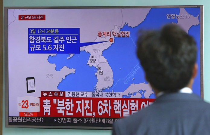 A man watches a TV news report about a possible nuclear test conducted by North Korea at the Seoul Railway station in Seoul, South Korea, Sunday, Sept. 3, 2017.(AP Photo/Ahn Young-joon)