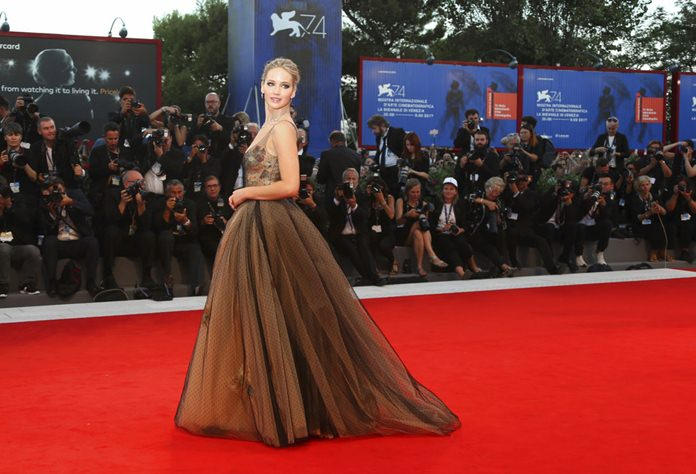 Actress Jennifer Lawrence poses for photographers at the premiere of the film 'mother!' at the 74th edition of the Venice Film Festival in Venice, Italy, Tuesday, Sept. 5, 2017. (Photo by Joel Ryan/Invision/AP)