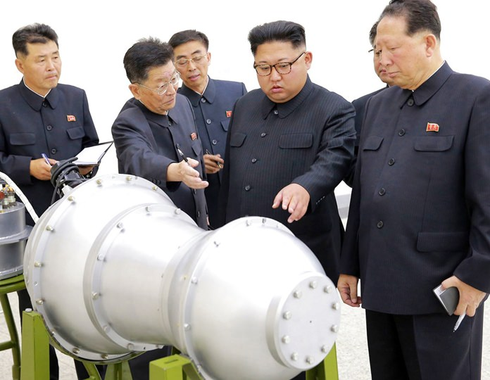This undated file photo distributed on Sunday, Sept. 3, 2017, by the North Korean government, shows North Korean leader Kim Jong Un, second from right, at an undisclosed location. (Korean Central News Agency/Korea News Service via AP)