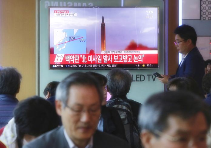 People watch a TV screen showing a file footage of North Korea's missile launch, at the Seoul Railway Station in Seoul, South Korea, Friday, Sept. 15, 2017. (AP Photo/Ahn Young-joon)