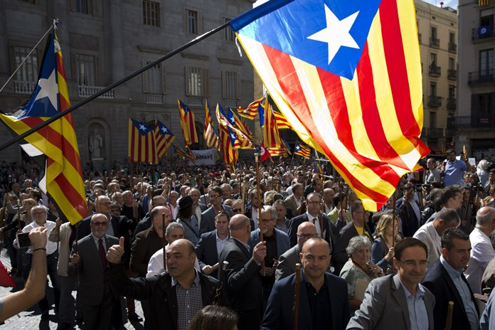 A number of the mayors under investigation take part in a march to protest against the ruling of the constitutional court ahead of a planned independence referendum in the Catalonia region, in Barcelona, Spain, Saturday, Sept. 16. (AP Photo/Emilio Morenatti)