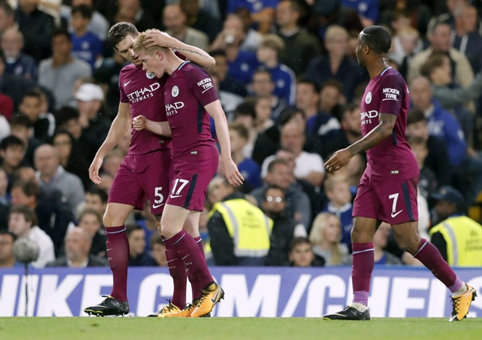 Manchester City's scorer Kevin De Bruyne, 2nd left, and his teammates John Stones, left, and Raheem Sterling, right, celebrate the winning goal during their English Premier League match against Chelsea at Stamford Bridge stadium in London, Saturday, Sept. 30. (AP Photo/Frank Augstein)