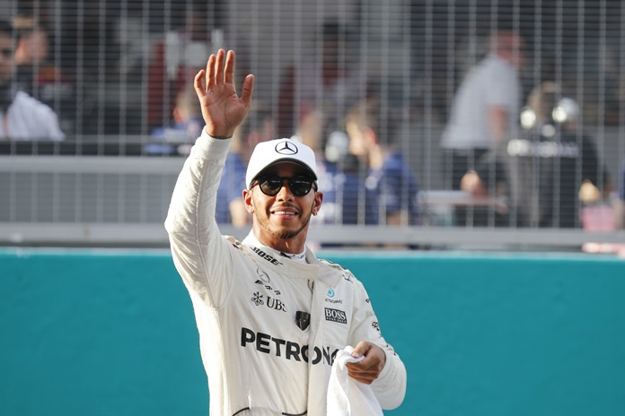 Mercedes driver Lewis Hamilton of Britain waves after the qualifying for the Malaysian Formula One Grand Prix in Sepang, Malaysia, Saturday, Sept. 30. (AP Photo/Vincent Thian)
