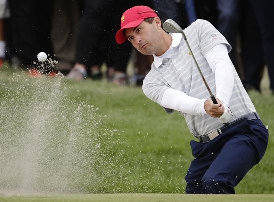 Kevin Kisner hits out of a bunker on the 16th hole during the third day of the Presidents Cup at Liberty National Golf Club in Jersey City, N.J., Saturday, Sept. 30. (AP Photo/Julio Cortez)