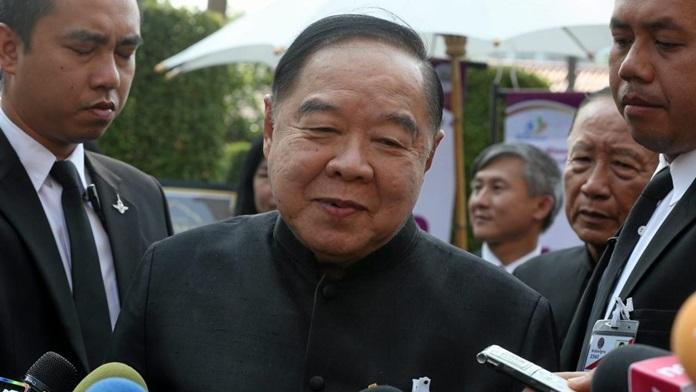 Deputy Prime Minister and Defense Minister Gen Prawit Wongsuwan talks to reporters in Bangkok, Saturday, Sept. 30.