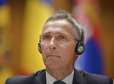 NATO Secretary General Jens Stoltenberg listens to a translation during the NATO Parliamentary Assembly session in Bucharest, Romania, Monday, Oct. 9. (AP Photo/Andreea Alexandru)