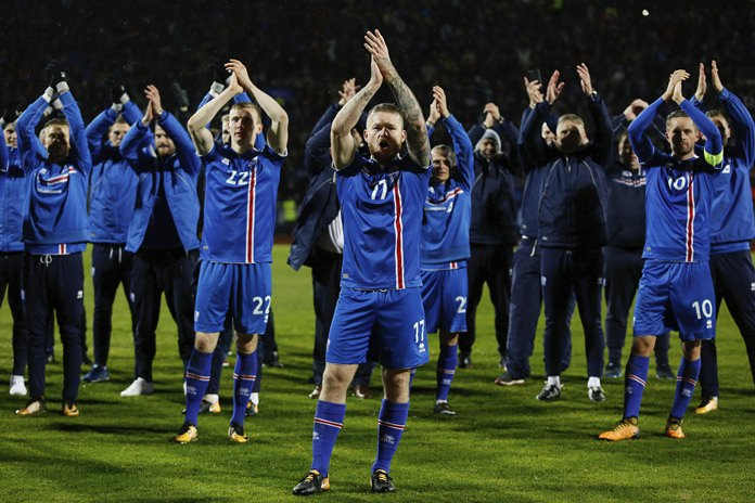 Iceland's captain Aron Gunnarsson celebrates with teammates at the end of the World Cup Group I qualifying match against Kosovo in Reykjavik, Iceland, Monday Oct. 9. (AP Photo/Brynjar Gunnarsson)