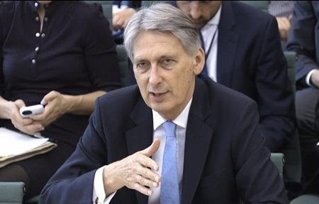 Britain's Chancellor of the Exchequer Philip Hammond answers questions at the parliamentary Commons Treasury Select Committee in London on Wednesday Oct. 11. (PA via AP)