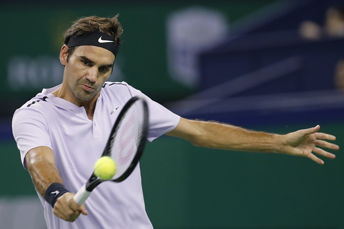 Roger Federer of Switzerland returns a backhand shot against Diego Schwartzman of Argentina during their men's singles match at the Shanghai Masters tennis tournament in Shanghai, China, Wednesday, Oct. 11. (AP Photo/Andy Wong)