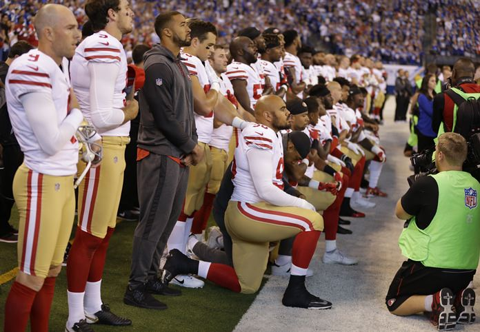 Members of the San Francisco 49ers kneel during the playing of the national anthem before an NFL football game against the Indianapolis Colts, Sunday, Oct. 8. (AP Photo/Michael Conroy)