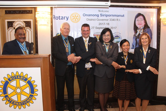 PDG Pratheep Malhotra (left) is all smiles as the leaders of Rotary stand hand in hand pledging to make a difference for humanity. (l-r) President Peter Schlegel, President Eric Larbouillat, DG Onanong Siripornmanut, President Nachlada Nammontree and President Dr. Margret Deter.