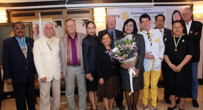 Members of the Rotary Club of Jomtien-Pattaya gather for a group photo with DG Onanong.