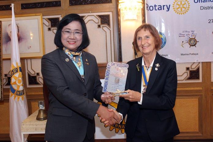 DG Onanong presents the Outstanding Women in Rotary Award to President Dr. Margret Deter.