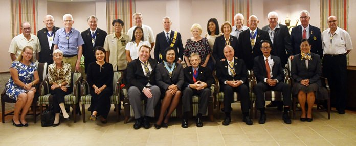 Members of the Rotary Club Eastern Seaboard gather for a group photograph with DG Onanong Siripornmanut.