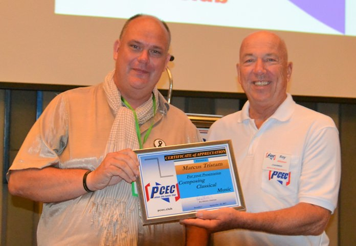 MC Roy Albiston presents the PCEC's Certificate of Appreciation to Marcus Tristan after his interesting and very entertaining presentation about his career and his musical compositions.