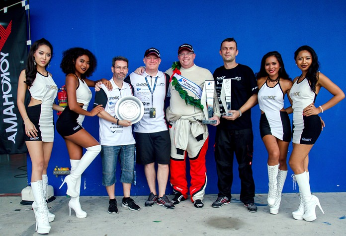 Danish driver Thomas Raldorf (5th left) celebrates with the Unixx–TR-Motorsport team after winning the GTC Supercar team championship and driver's title at the Chang International Circuit in Buriram, Sunday, Sept. 24.