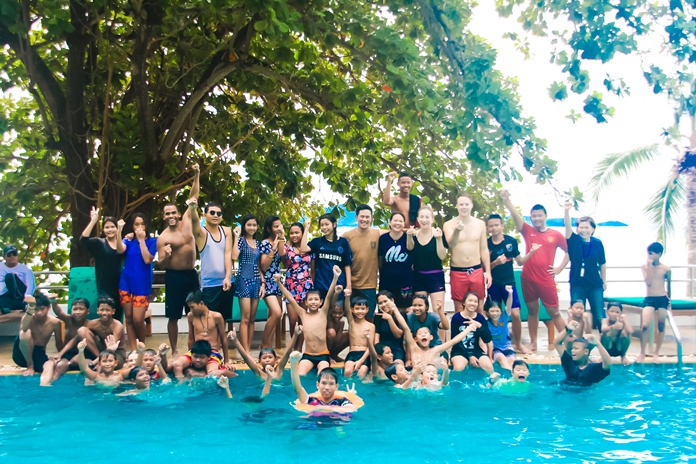 Youths and chaperones having fun at the pool.