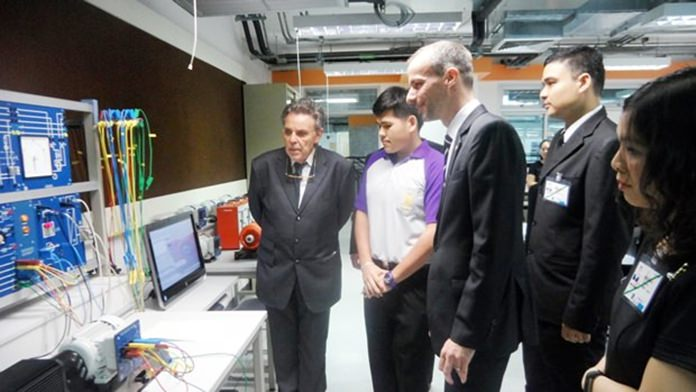 The entourage is given a tour through the Technology College.