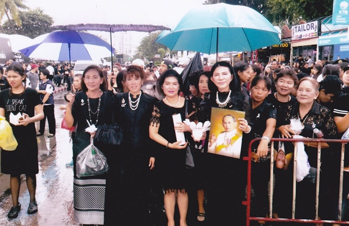 Maleewan Ketkaptan waits in line with members of the Banglamung Red Cross District Branch to pay respect to HM King Bhumibol.