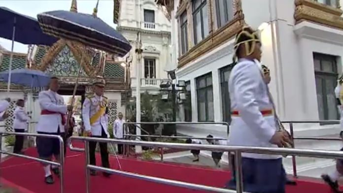 His Majesty King Maha Vajiralongkorn arrives at the Dusit Maha Prasat Throne Hall in the Grand Palace in order to make merit for the late King Rama IX.