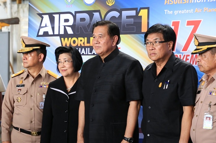Deputy Prime Minister and Defense Minister, Gen. Thanasak Patimapakorn (centre) poses for a photo after attending a meeting at Sattahip naval base to discuss preparations for the upcoming Air Race 1 World Cup.