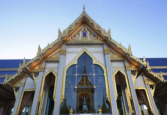 The royal crematorium and funeral complex for the late Thai King Bhumibol Adulyadej is reflected in a pavilion window. (AP Photo/Sakchai Lalit)