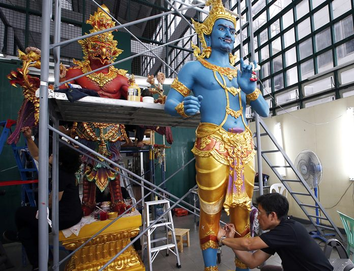Thai artists and craftsmen are putting the finishing touches on an elaborate crematorium complex ahead of the funeral of King Bhumibol Adulyadej, who reigned for 70 years before his death on Oct. 13, 2016. (AP Photo/Sakchai Lalit)