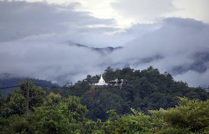 A Buddhist monastery sits atop a hill in Mae Sariang, northern Thailand. The mountains of northern Thailand were seeded by hundreds of projects initiated by the His Majesty late King Bhumibol Adulyadej. (AP Photo/Denis Gray)