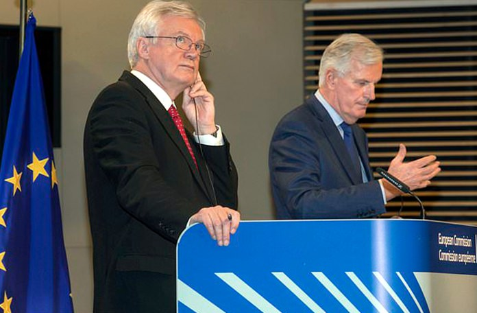 British Secretary of State for Exiting the European Union, David Davis left, and European Union chief Brexit negotiator Michel Barnier participate in a media conference at EU headquarters in Brussels on Thursday, Oct. 12. (AP Photo/Olivier Matthys)