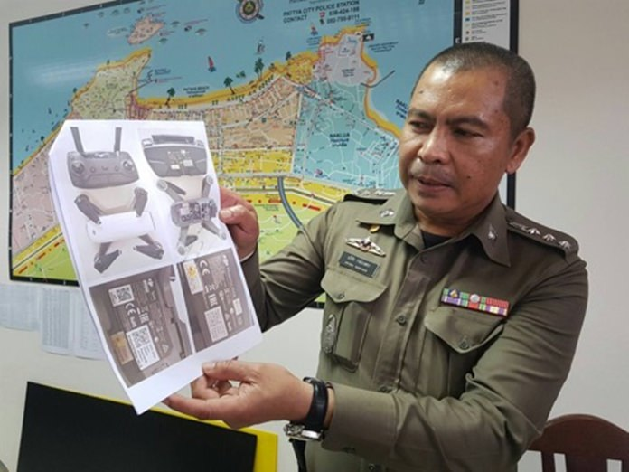 Pattaya police chief Pol. Col. Apichai Kroppech holds up photos of a drone aircraft during a meeting with the press, Thursday, Oct. 12. On the same day, the National Broadcasting and Telecommunications Commission imposed a ban on all unregistered drones allowing a 90-day grace period before owners face possible prosecution.