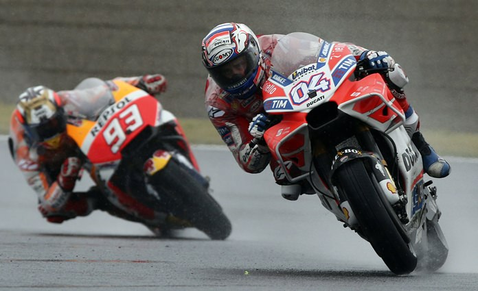 Italy's Andrea Dovizioso, right, steers his Ducati tailed by Spain's Marc Marquez on the way to winning the MotoGP Japanese Motorcycle Grand Prix at the Twin Ring Motegi circuit in Motegi, north of Tokyo, Sunday, Oct. 15. (AP Photo/Shizuo Kambayashi)