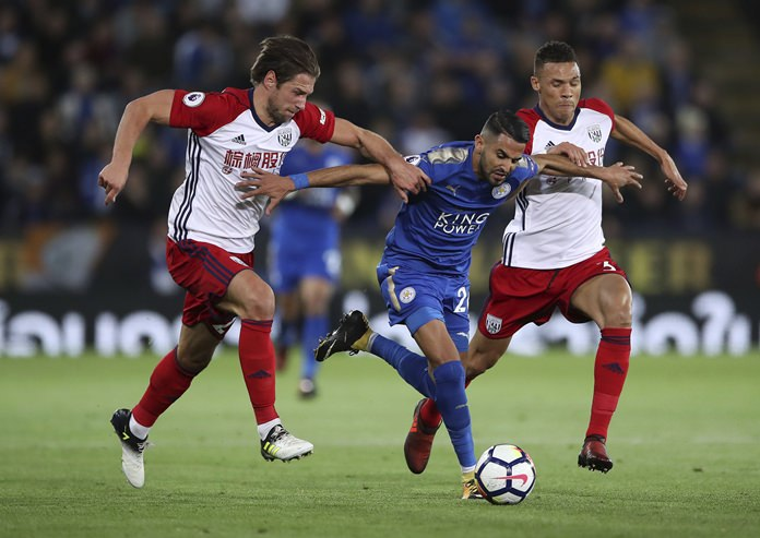 Leicester City's Riyad Mahrez, center, breaks through the West Bromwich Albion defence during the English Premier League match at the King Power Stadium in Leicester, Monday, Oct. 16. (Nick Potts/PA via AP)