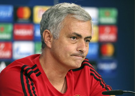 Manchester United coach Jose Mourinho listens to questions during a news conference at Benfica's Luz stadium in Lisbon, Tuesday, Oct. 17. (AP Photo/Armando Franca)