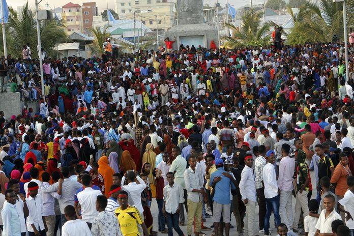 Protesters march near the scene of Saturday's massive truck bomb attack in Mogadishu, Somalia, Wednesday, Oct. 18. (AP Photo/Farah Abdi Warsameh)
