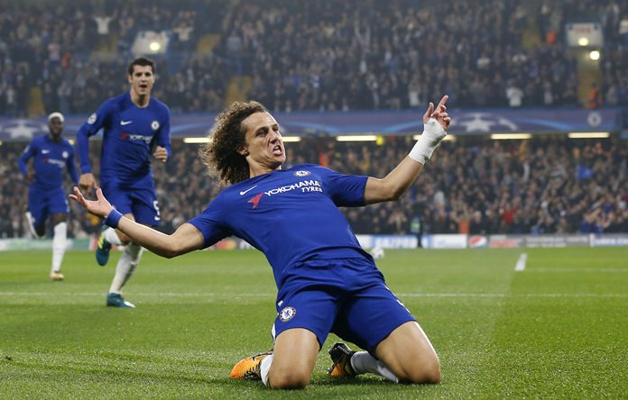 Chelsea's David Luiz celebrates after scoring during the Champions League group C match against Roma at Stamford Bridge stadium in London, Wednesday, Oct. 18. (AP Photo/Frank Augstein)