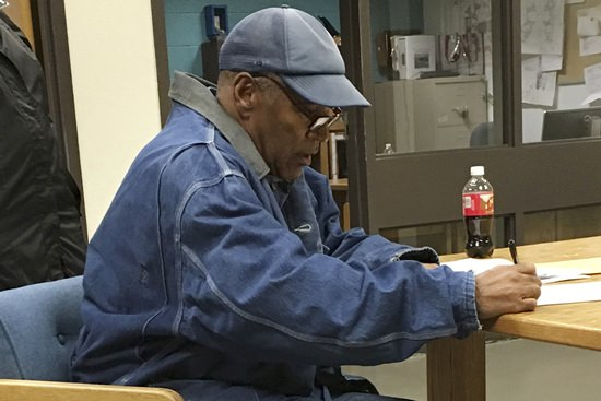 Former football legend O.J. Simpson signs documents at the Lovelock Correctional Center, Saturday, Sept. 30, 2017, in Lovelock, Nev. Simpson was released from the Lovelock Correctional Center in northern Nevada early Sunday, Oct. 1. (Brooke Keast/Nevada Department of Corrections via AP)