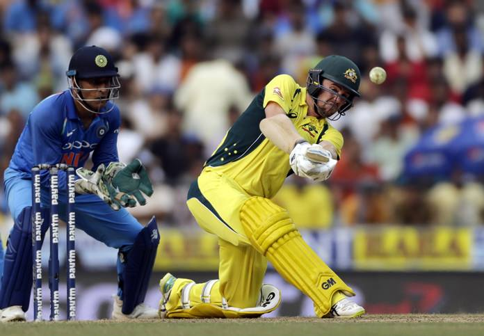 Australia's Travis Head, right, bats during the fifth one-day international cricket match between India and Australia in Nagpur, India, Sunday, Oct. 1. (AP Photo/Rajanish Kakade)
