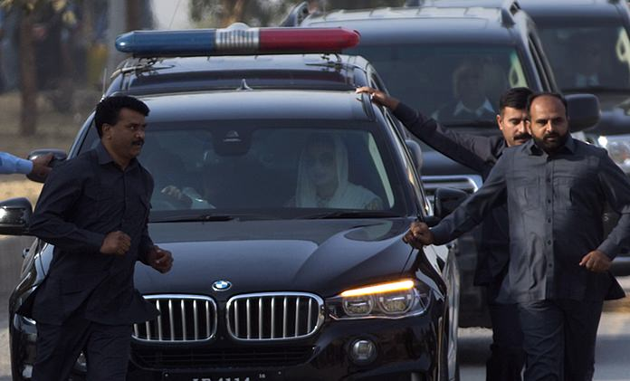 Maryam Nawaz, daughter of former Prime Minister Nawaz Sharif, right front passenger in vehicle, arrives at an accountability court in Islamabad, Pakistan, Thursday, Oct. 19. (AP Photo/B.K. Bangash)