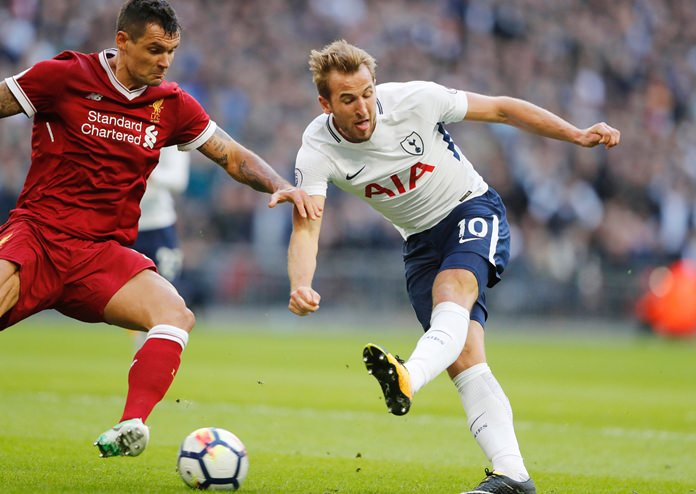 Tottenham's Harry Kane, right, and Liverpool's Dejan Lovren challenge for the ball during the English Premier League soccer match between Tottenham Hotspur and Liverpool at Wembley Stadium in London, Sunday, Oct. 22.(AP Photo/Frank Augstein)