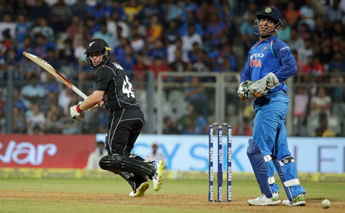 New Zealand's Tom Latham plays a shot during the first one-day international cricket match against India in Mumbai, India, Sunday, Oct. 22. (AP Photo/Rafiq Maqbool)