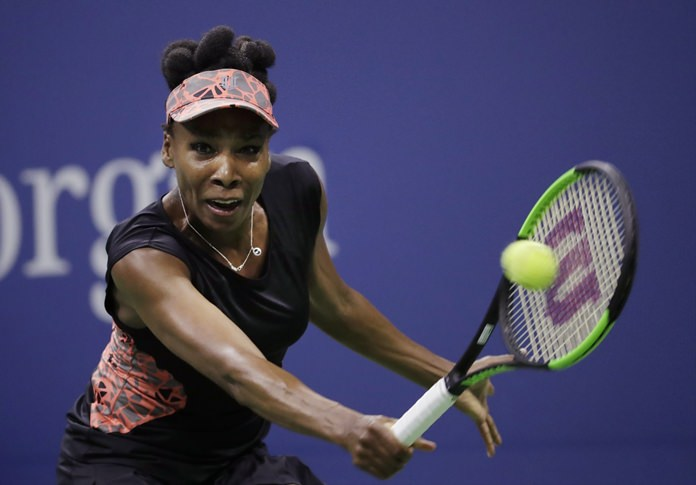 Venus Williams needed three match points and more than three hours to defeat Jelena Ostapenko 7-5, 6-7 (3), 7-5 at the WTA Finals in Singapore on Tuesday, Oct. 24. (AP Photo/Julio Cortez, File)