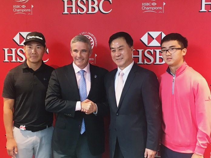 PGA Tour commissioner Jay Monahan, center left, shakes hands with Zhang Xiaoning, president of the China Golf Association, after announcing a deal at the WGC-HSBC Champions golf tournament in Shanghai on Wednesday, Oct. 25. (AP Photo/Doug Ferguson)