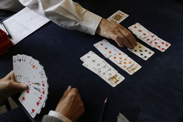 In this Sept. 22, 2015 file photo, competitors play bridge at the Acol Bridge Club in West Hampstead, London. (AP Photo/Tim Ireland)