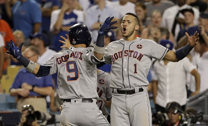 Houston Astros' Marwin Gonzalez celebrates his home run with Carlos Correa during the ninth inning of Game 2 of baseball's World Series against the Los Angeles Dodgers, Wednesday, Oct. 25, in Los Angeles. (AP Photo/Matt Slocum)