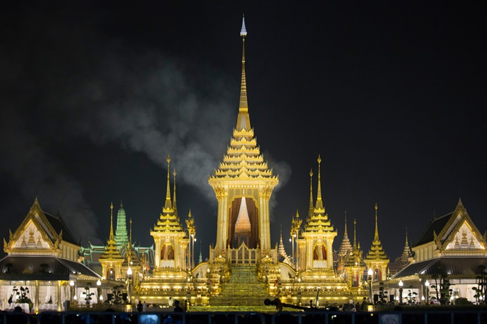 Smoke rises from the royal crematorium of His Majesty the late King Bhumibol Adulyadej in Bangkok, early Friday, Oct. 27, 2017. (AP Photo/Wason Wanichakorn)