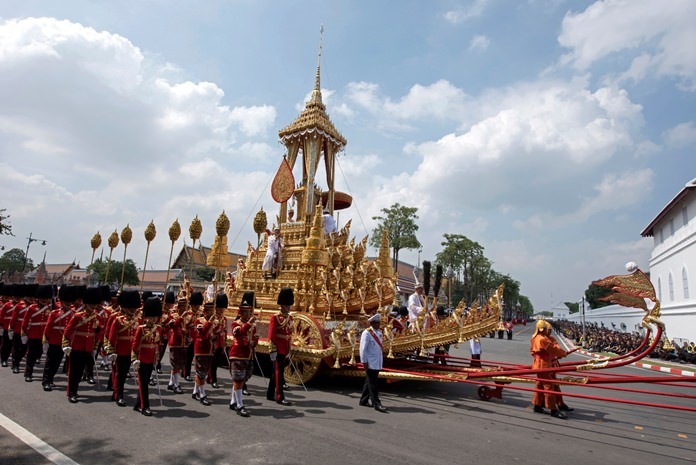 The symbolic urn of HM the late King Bhumibol Adulyadej is transported to the spectacular golden crematorium during the funeral procession in Bangkok, Thursday, Oct. 26. (AP Photo/Kittinun Rodsupan)