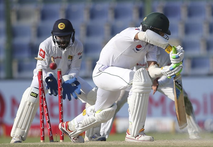 Pakistan's Mohammad Amir is bowled by Sri Lanka's Rangana Herath during the fifth day of the first test in Abu Dhabi, United Arab Emirates, Monday, Oct. 2. (AP Photo/Kamran Jebreili)