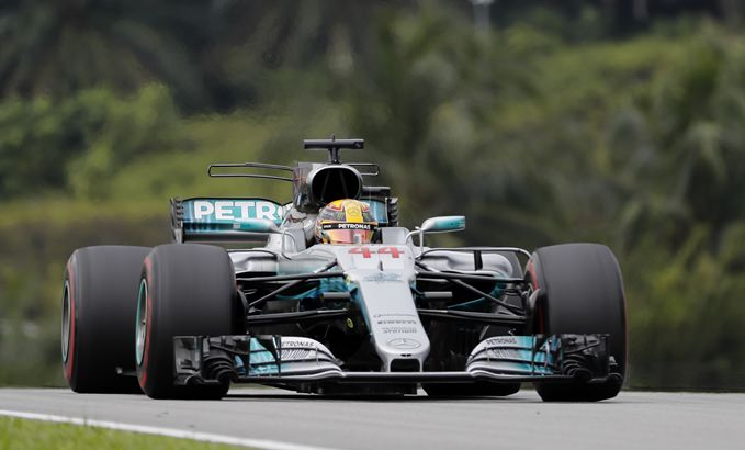 Mercedes driver Lewis Hamilton of Britain steers his car during the Malaysian Formula One Grand Prix at the Sepang International Circuit in Sepang, Malaysia, Sunday, Oct. 1. (AP Photo/Vincent Thian)